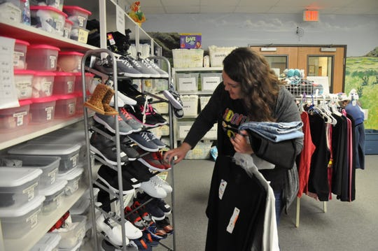 Casandra Browne, an adoption specialist with Texas Child Protective Services, shops in the Blue Bonnet Room for shoes and clothing for a client March 15.