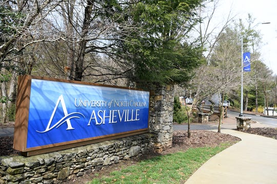 The UNC Asheville sign at the roundabout that leads onto the campus.