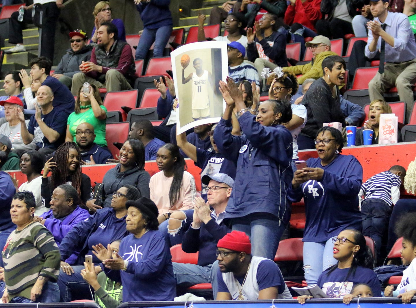 Poughkeepsie fans cheer their team during a win over Manhasset in a during a Class A boys basketball state semifinal March 15, 2019 at Floyd L. Maines Veterans Memorial Arena in Binghamton.