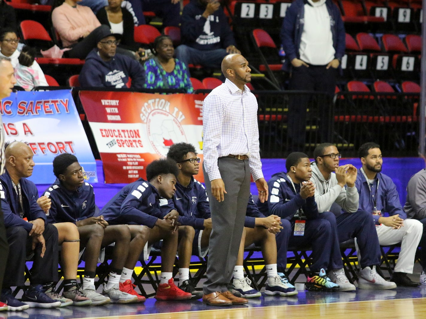 Poughkeepsie head coach Cody Moffett on the sideline against Manhasset during a Class A boys basketball state semifinal March 15, 2019 at Floyd L. Maines Veterans Memorial Arena in Binghamton.