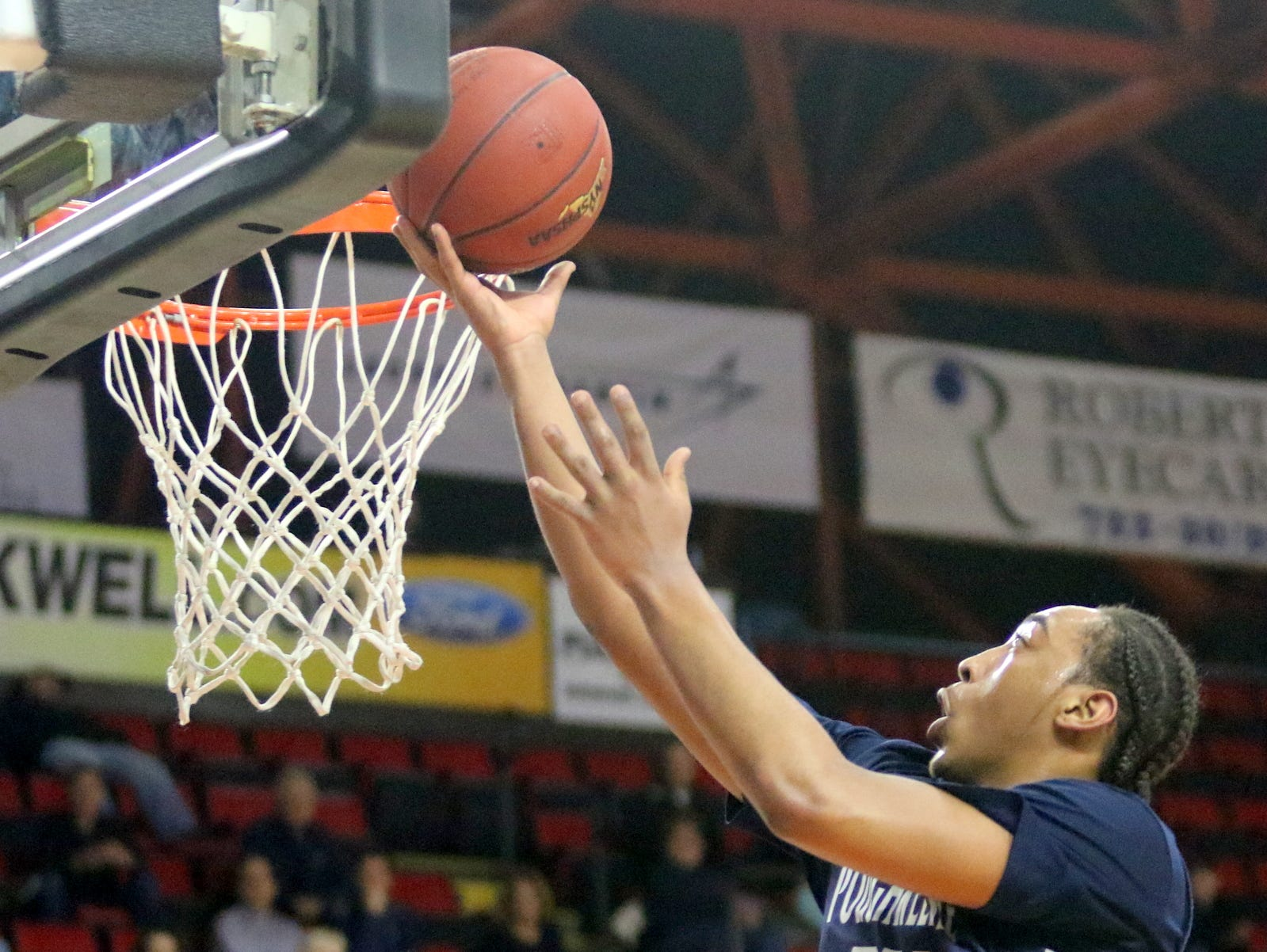 Davontrey Thomas of Poughkeepsie goes in for a layup against Manhasset during a Class B boys basketball state semifinal March 15, 2019 at Floyd L. Maines Veterans Memorial Arena in Binghamton.