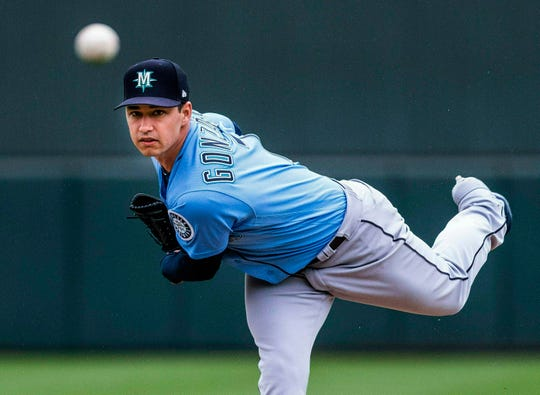 Seattle Mariners' Marco Gonzalez throws against the Oakland Athletics during a spring training baseball game, in Mesa, Ariz.  Seattle acquired a number of key prospects that could be ready to contribute in two years. It kept a handful of core players.