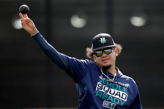 Seattle Mariners pitcher Felix Hernandez throws during spring training baseball practice, in Peoria, Ariz.