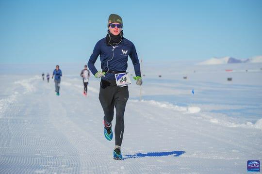 Greg Nance running in a marathon in Antarctica as part of the 2019 World Marathon Challenge.