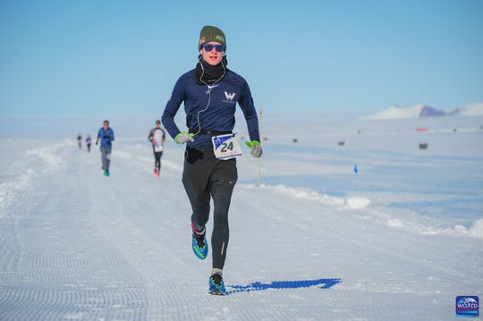 Greg Nance running in a marathon in Antarctica as part of the 2019 World Marathon Challenge.