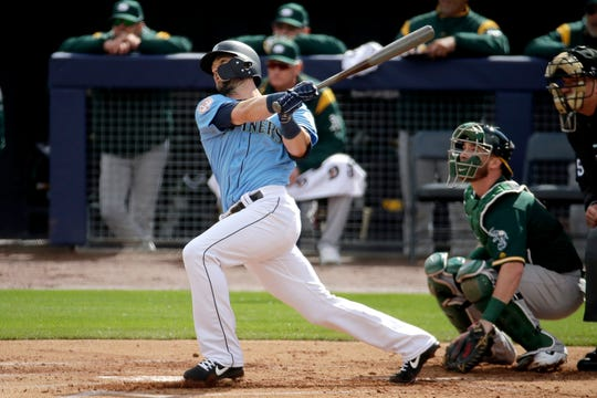 Seattle Mariners' Mitch Haniger hits a two-run home run during the first inning of a spring training baseball game against the Oakland Athletics.  Seattle acquired a number of key prospects that could be ready to contribute in two years. It kept a handful of core players _ Mitch Haniger, Marco Gonzales among them.