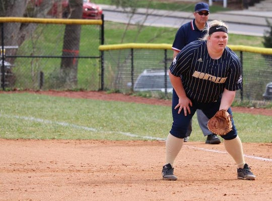 Montreat College junior Abby Swilley, or Riceville, Tennessee, gets in fielding position at first base.