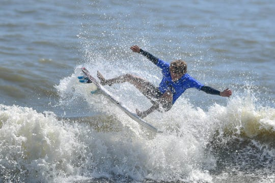 Noah Schweizer of New Smyrna Beach grabs some air at the Beach 'N Boards Fest in Cocoa Beach.