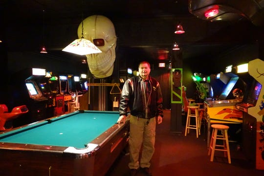 Manager Bill Taylor stands in the main arcade area at Flashback Vintage Game Room, 223 N. Sandusky Ave.