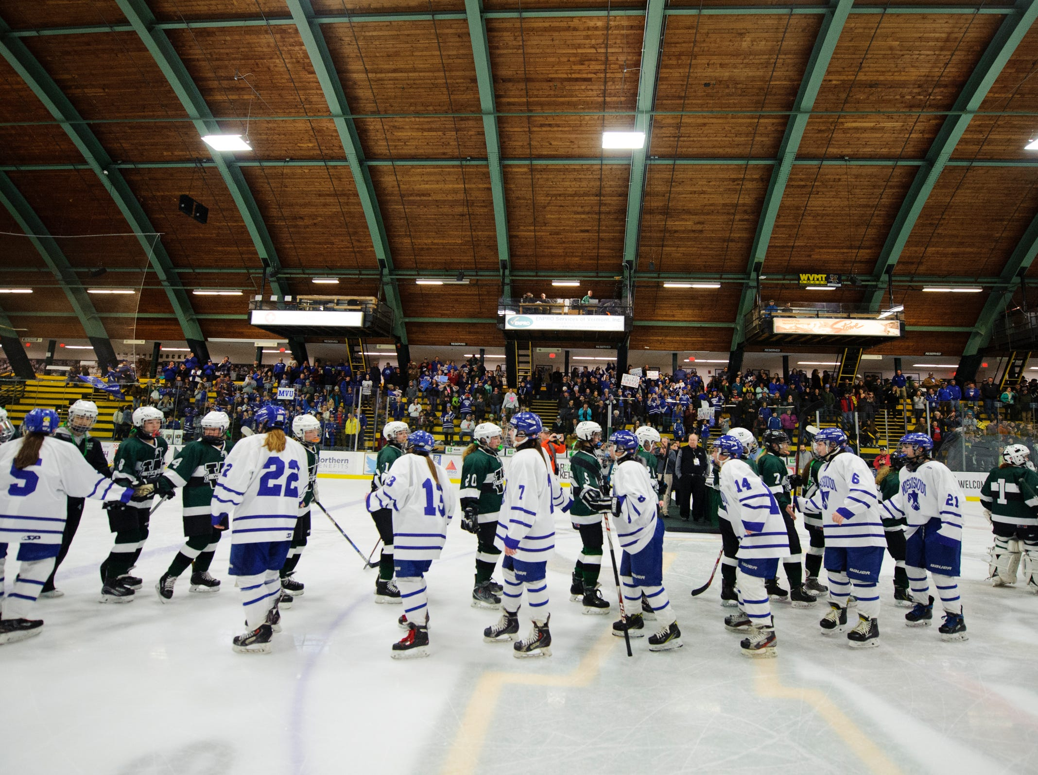 The teams shake hands during the DII girls hockey championship game between the Woodstock Wasps and the Missisquoi Thunderbirds at Gutterson Field House on Thursday night March 14, 2019 in Burlington, Vermont.