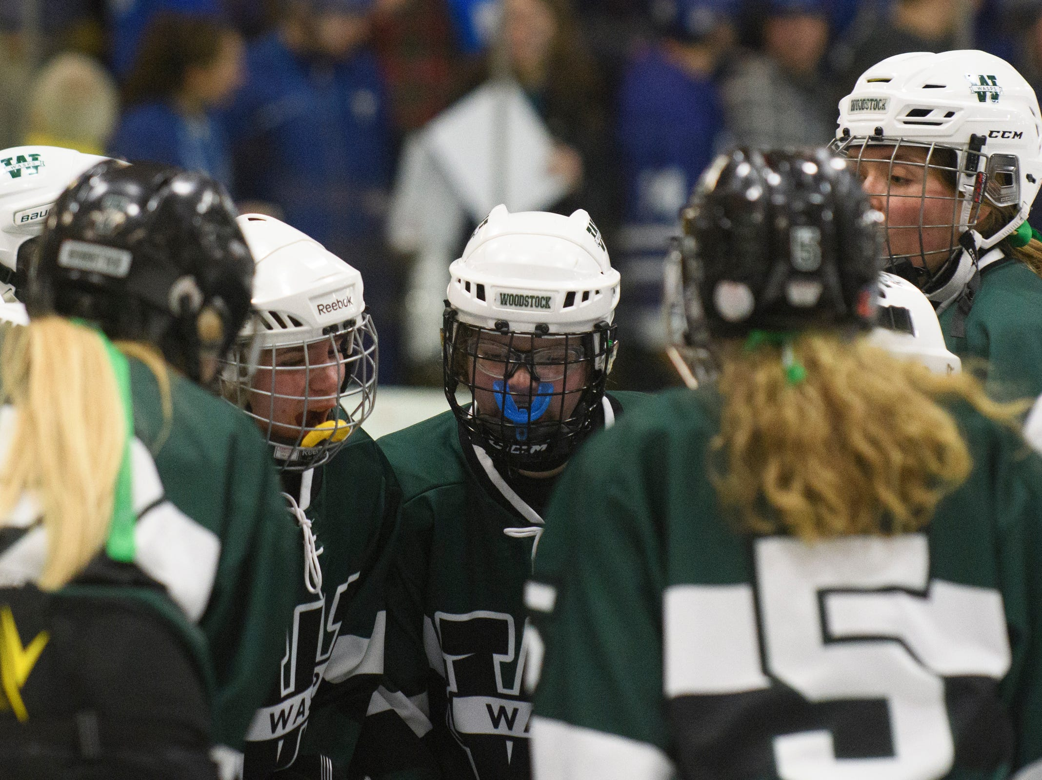 Woodstock huddles together during the DII girls hockey championship game between the Woodstock Wasps and the Missisquoi Thunderbirds at Gutterson Field House on Thursday night March 14, 2019 in Burlington, Vermont.