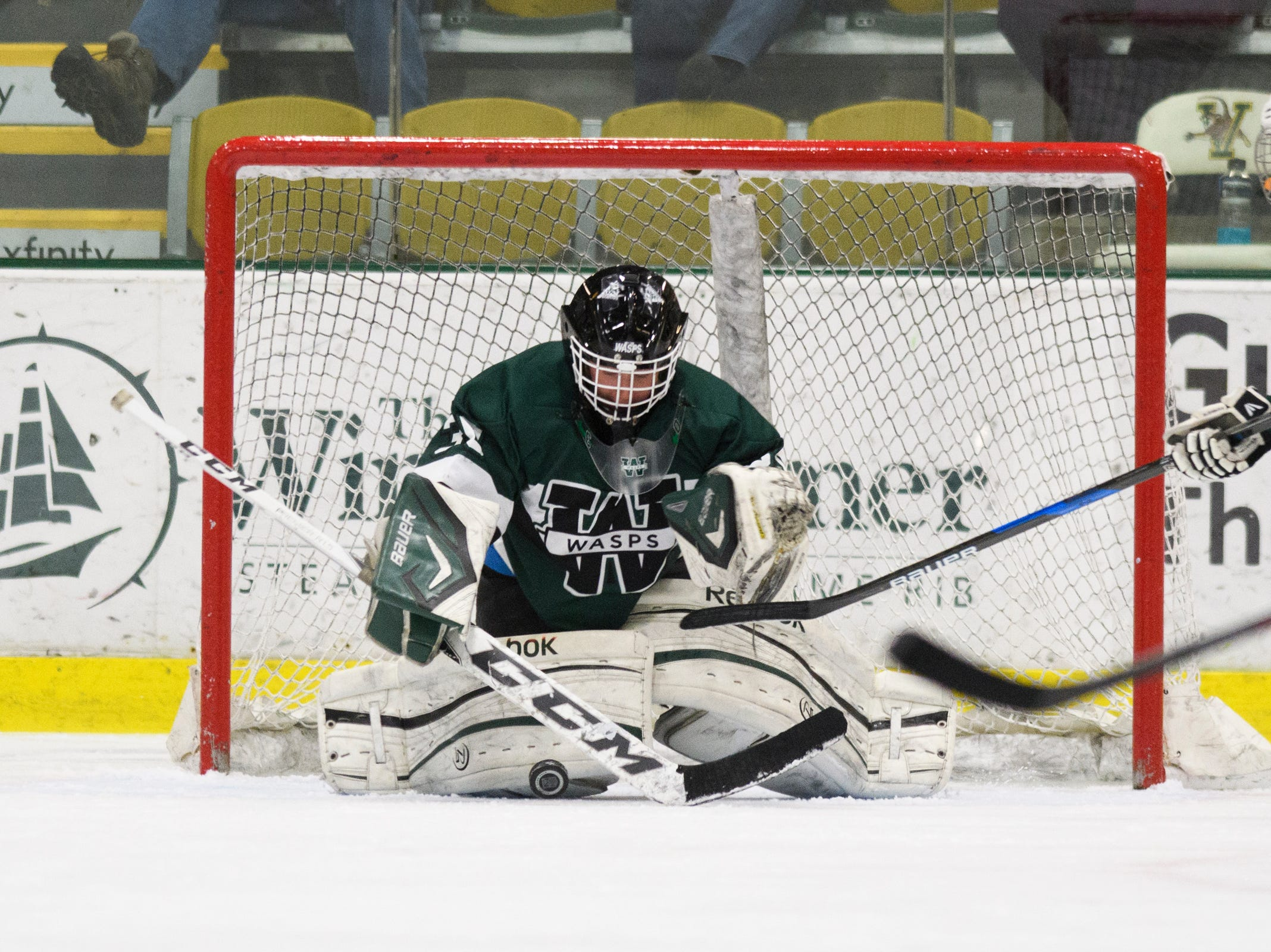 Woodstock goalie Bridgit Black (30) makes a save during the DII girls hockey championship game between the Woodstock Wasps and the Missisquoi Thunderbirds at Gutterson Field House on Thursday night March 14, 2019 in Burlington, Vermont.