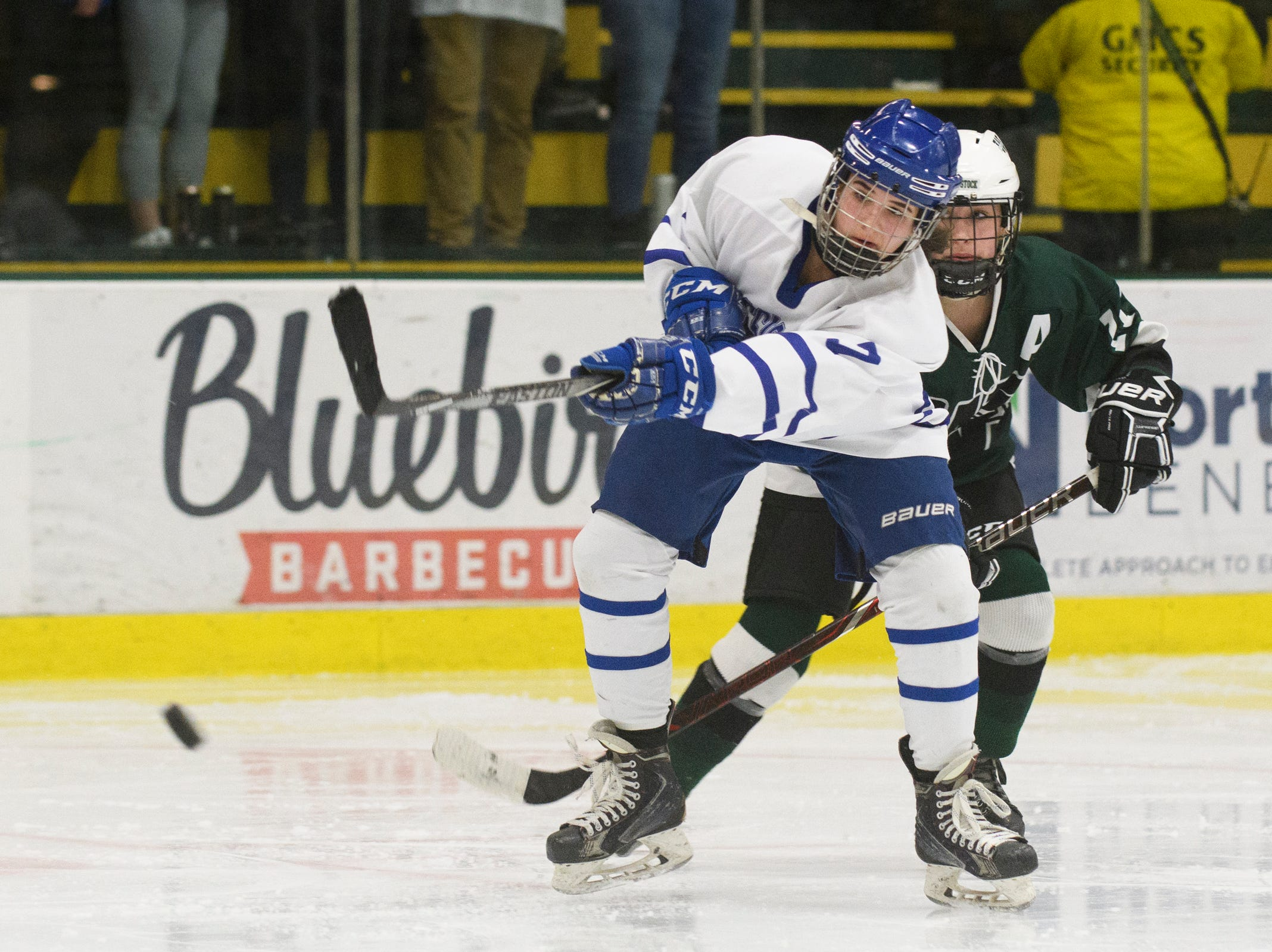 Missisquoi's Lora Fresn (7) shoots the puck during the DII girls hockey championship game between the Woodstock Wasps and the Missisquoi Thunderbirds at Gutterson Field House on Thursday night March 14, 2019 in Burlington, Vermont.