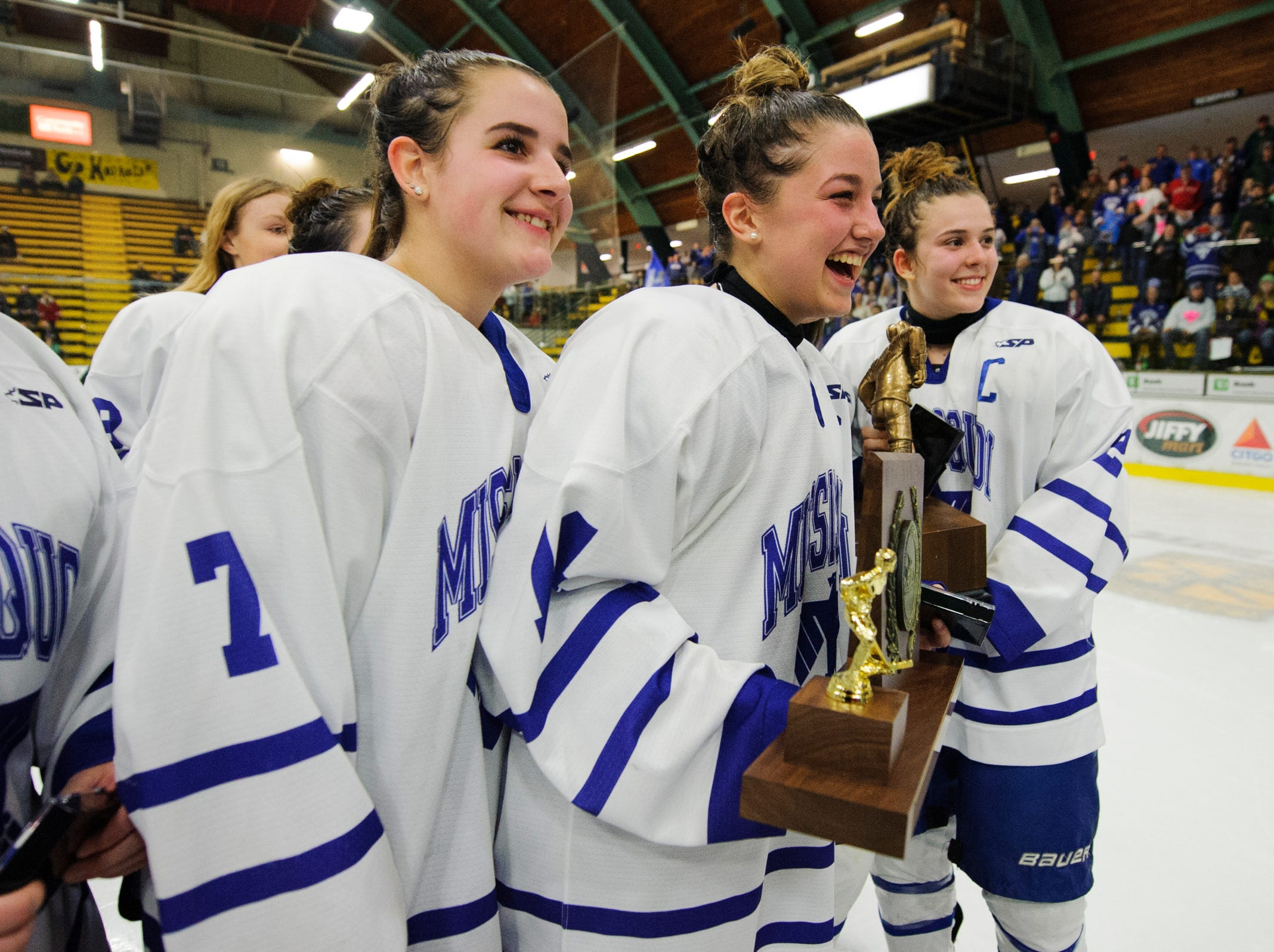 Missisquoi celebrates the championship during the DII girls hockey championship game between the Woodstock Wasps and the Missisquoi Thunderbirds at Gutterson Field House on Thursday night March 14, 2019 in Burlington, Vermont.
