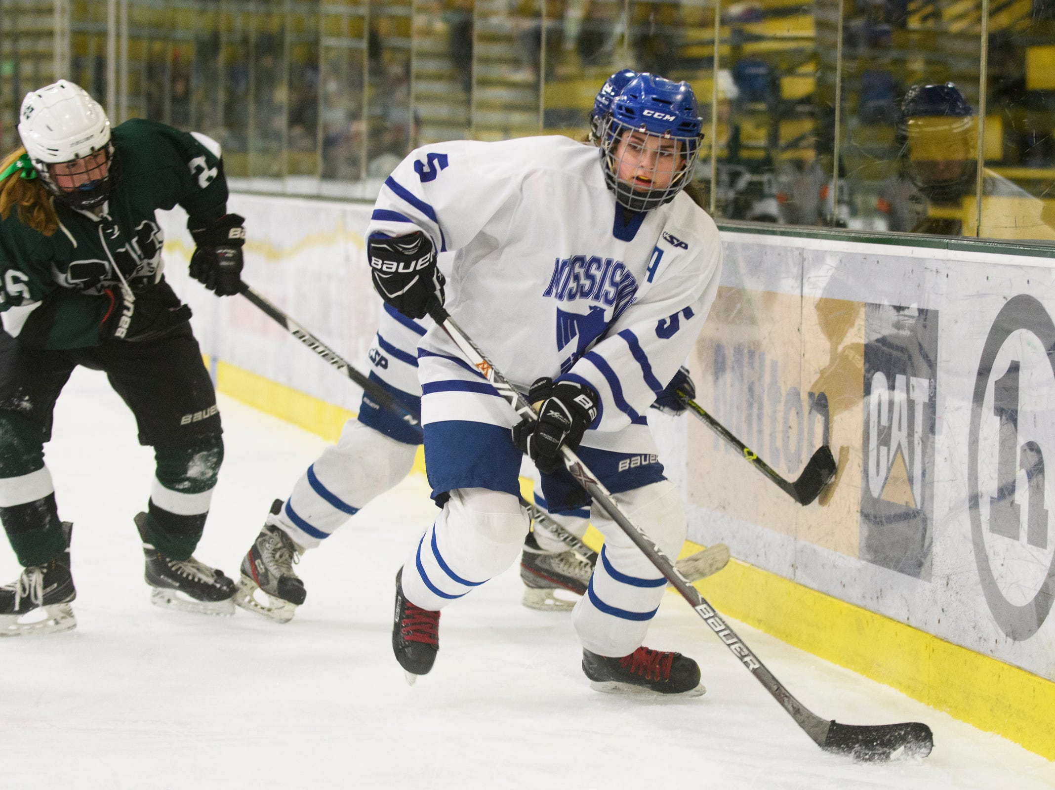 Missisquoi's Brianna Parent (5) looks to pass the puck during the DII girls hockey championship game between the Woodstock Wasps and the Missisquoi Thunderbirds at Gutterson Field House on Thursday night March 14, 2019 in Burlington, Vermont.