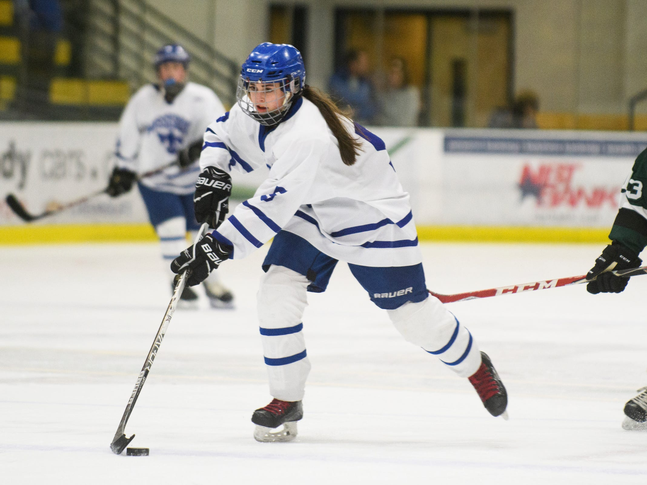 Missisquoi's Brianna Parent (5) skates down the ice with the puck during the DII girls hockey championship game between the Woodstock Wasps and the Missisquoi Thunderbirds at Gutterson Field House on Thursday night March 14, 2019 in Burlington, Vermont.