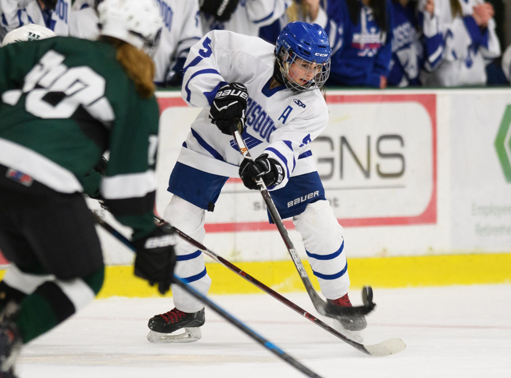 Missisquoi's Brianna Parent (5) shoots the puck during the DII girls hockey championship game between the Woodstock Wasps and the Missisquoi Thunderbirds at Gutterson Field House on Thursday night March 14, 2019 in Burlington, Vermont.