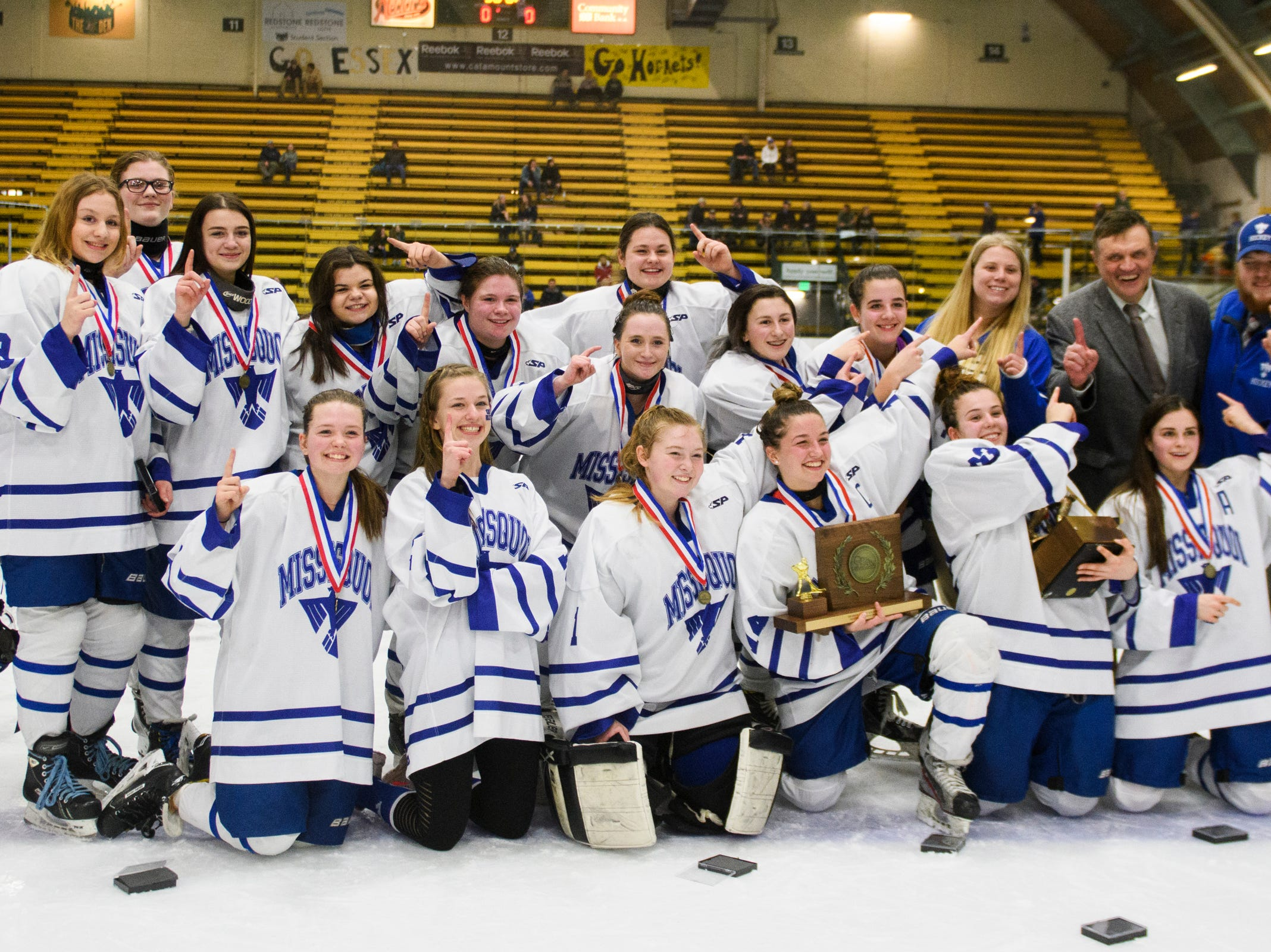Missisquoi pose for a portrait with the championship trophy during the DII girls hockey championship game between the Woodstock Wasps and the Missisquoi Thunderbirds at Gutterson Field House on Thursday night March 14, 2019 in Burlington, Vermont.
