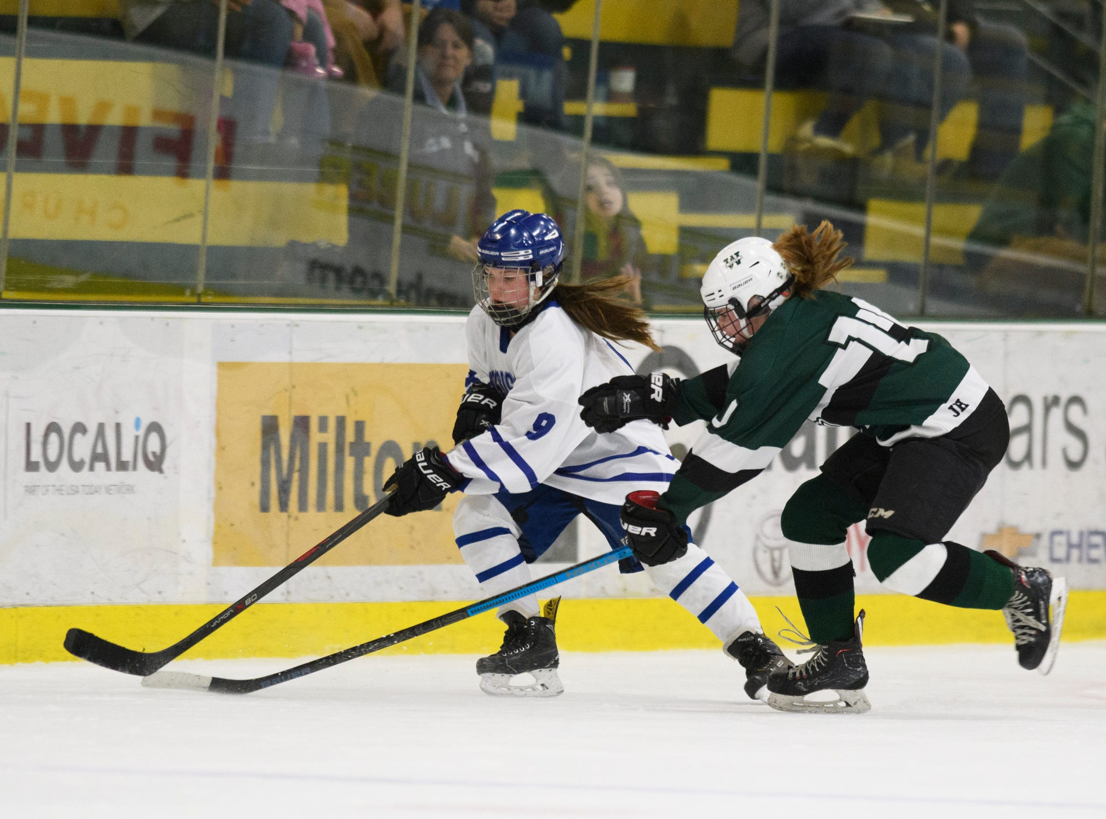 Woodstock's Allie Cimis (10) and Missisquoi's Abigail Bessette (9) chase down the puck during the DII girls hockey championship game between the Woodstock Wasps and the Missisquoi Thunderbirds at Gutterson Field House on Thursday night March 14, 2019 in Burlington, Vermont.