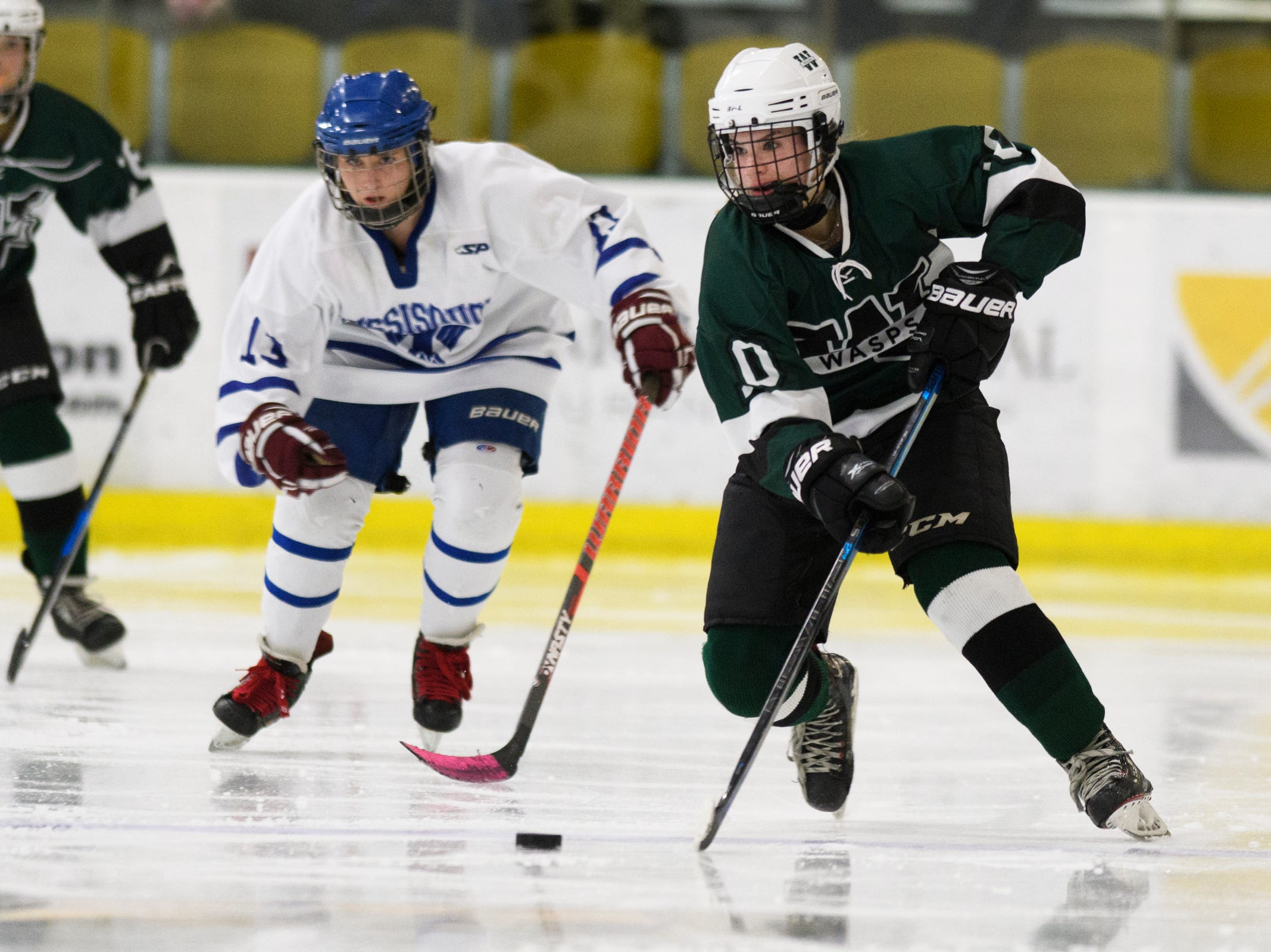Woodstock's Allie Cimis (10) skates down the ice with eh puck past Missisquoi's Reghan Overton (13) during the DII girls hockey championship game between the Woodstock Wasps and the Missisquoi Thunderbirds at Gutterson Field House on Thursday night March 14, 2019 in Burlington, Vermont.