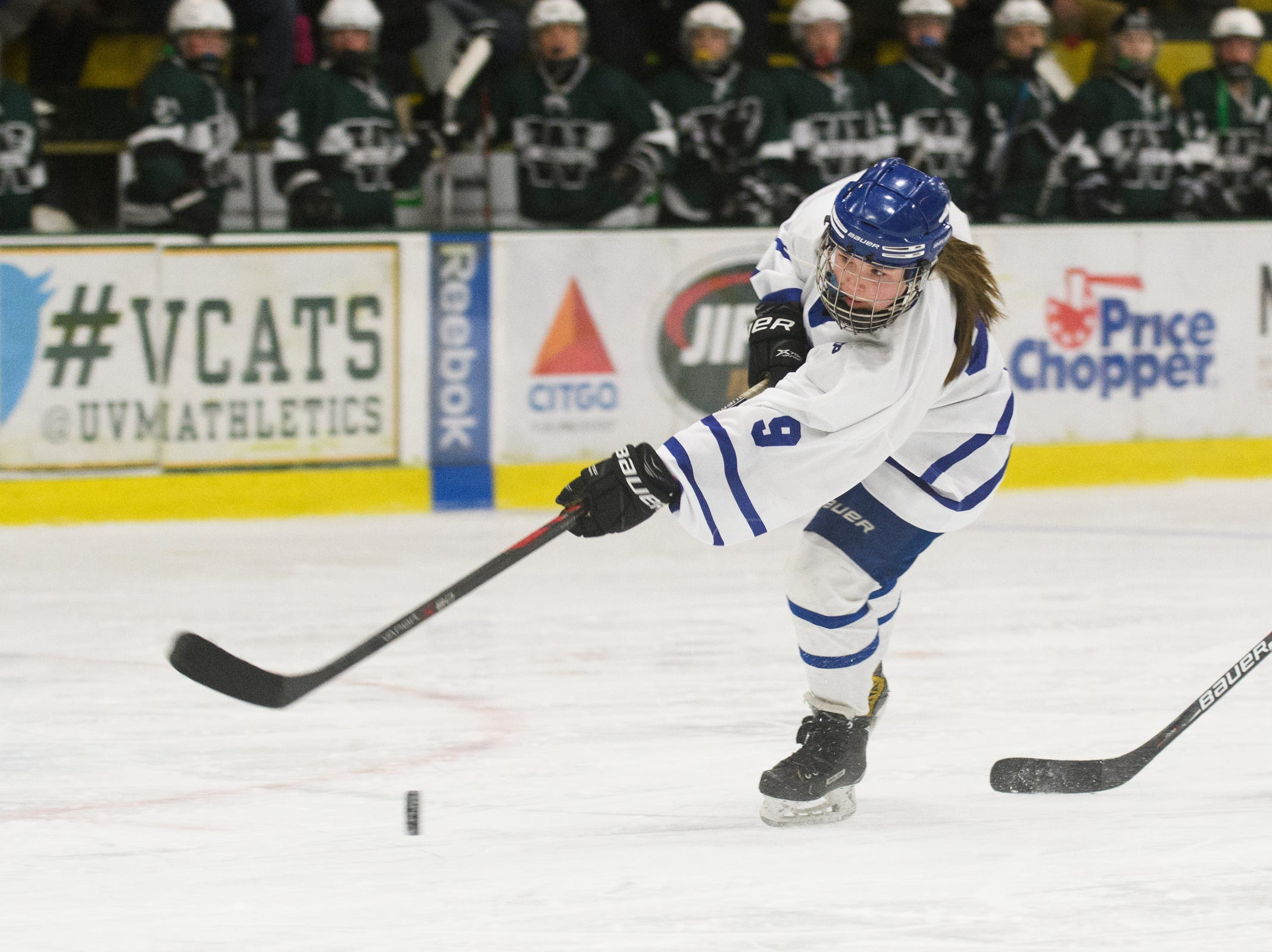 Missisquoi's Abigail Bessette (9) shoots the puck during the DII girls hockey championship game between the Woodstock Wasps and the Missisquoi Thunderbirds at Gutterson Field House on Thursday night March 14, 2019 in Burlington, Vermont.