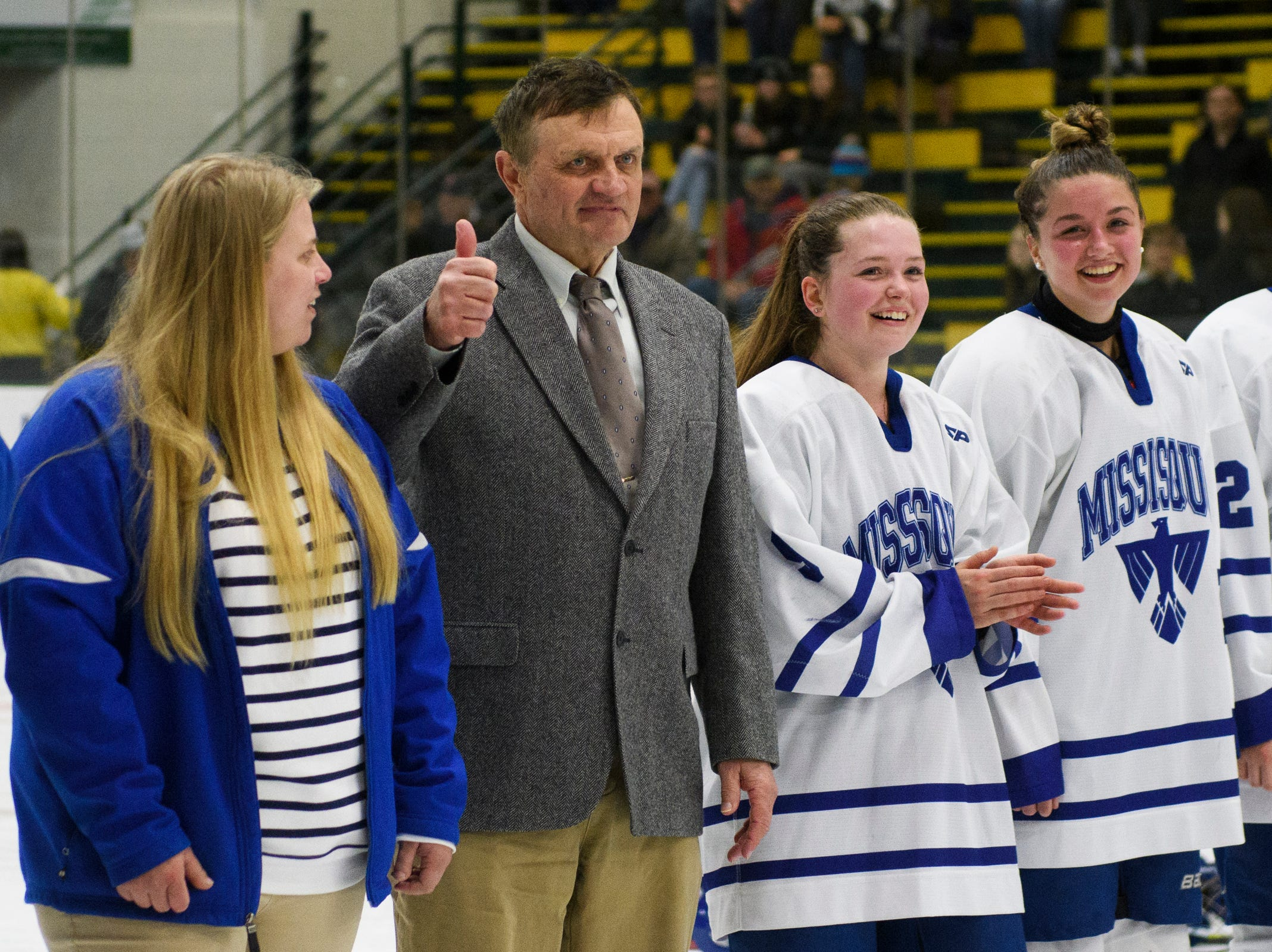 Missisquoi head coach Wynn Paradee gives the thumbs up during the DII girls hockey championship game between the Woodstock Wasps and the Missisquoi Thunderbirds at Gutterson Field House on Thursday night March 14, 2019 in Burlington, Vermont.
