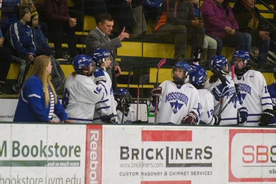 Missisquoi head coach Wynn Paradee talks to the team on the bench during the DII girls hockey championship game between the Woodstock Wasps and the Missisquoi Thunderbirds at Gutterson Field House on Thursday night March 14, 2019 in Burlington, Vermont.