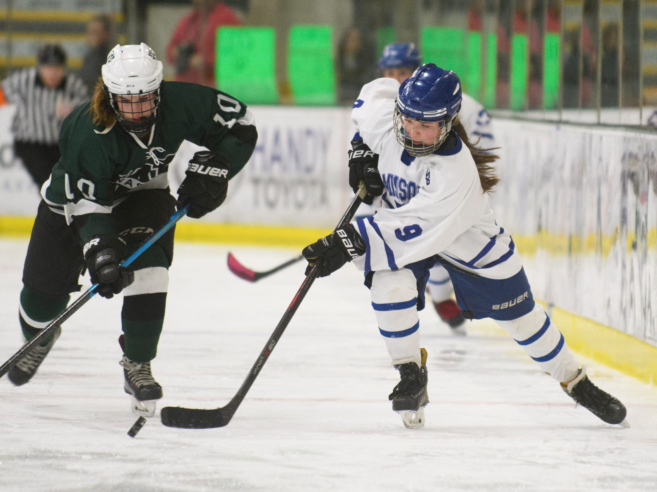 Missisquoi's Abigail Bessette (9) skates down the ice with the puck during the DII girls hockey championship game between the Woodstock Wasps and the Missisquoi Thunderbirds at Gutterson Field House on Thursday night March 14, 2019 in Burlington, Vermont.