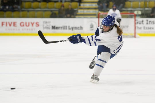 Missisquoi's Renee Bouchard (22) shoots the puck during the DII girls hockey championship game between the Woodstock Wasps and the Missisquoi Thunderbirds at Gutterson Field House on Thursday night March 14, 2019 in Burlington, Vermont.