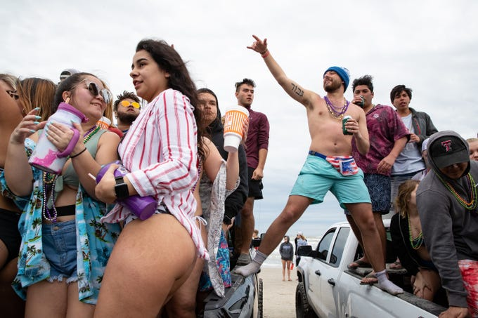 People celebrate spring break 2019 on the beach in Port  Aransas on Friday, March 15, 2019.