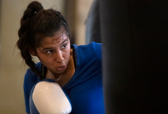 Dajia Contrearas warms up at Corpus Christi Police Officers Association, Wednesday, March 13, 2019. Contrearas is Corpus Christi's first female golden gloves state champion.