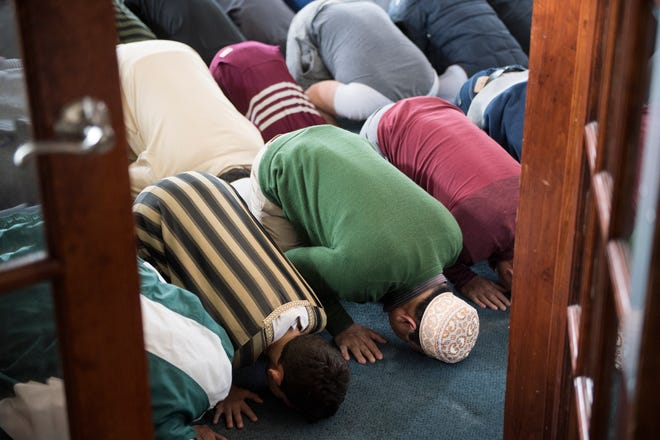 Worshipers pray during a packed service Friday, March 15, 2019 at the Muslim American Community Association in Voorhees, N.J.