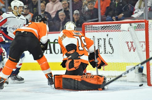 Mar 14, 2019; Philadelphia, PA, USA; Washington Capitals center Lars Eller (20) scores a goal against Philadelphia Flyers goaltender Carter Hart (79) during the first period at Wells Fargo Center. Mandatory Credit: Eric Hartline-USA TODAY Sports