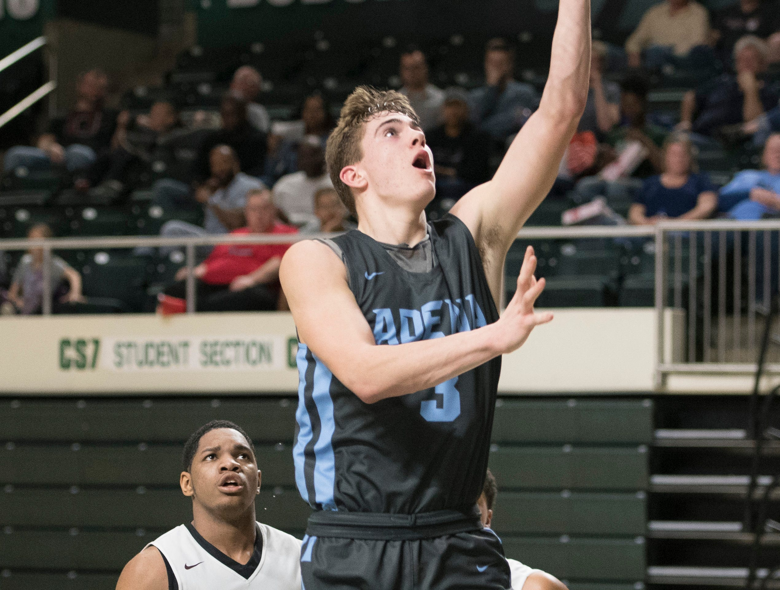 Adena senior Zach Fout takes it to the rim to score against Harvest Prep Thursday night in a Division III regional semifinal game at Ohio University's Convocation Center on March 14, 2019. Adena lost to Harvest Prep 79-38.