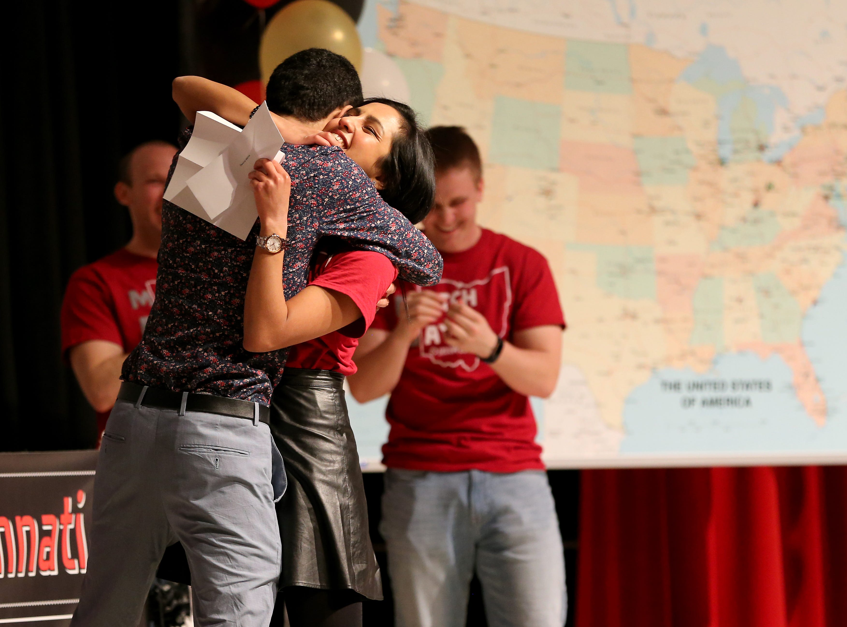 Devina Mehta, right, hugs her brother, Neil, after finding out she will be doing her residency in dermatology at Cornell University, during Match Day, Friday, March 15, 2019, at the University of Cincinnati's College of Medicine.
