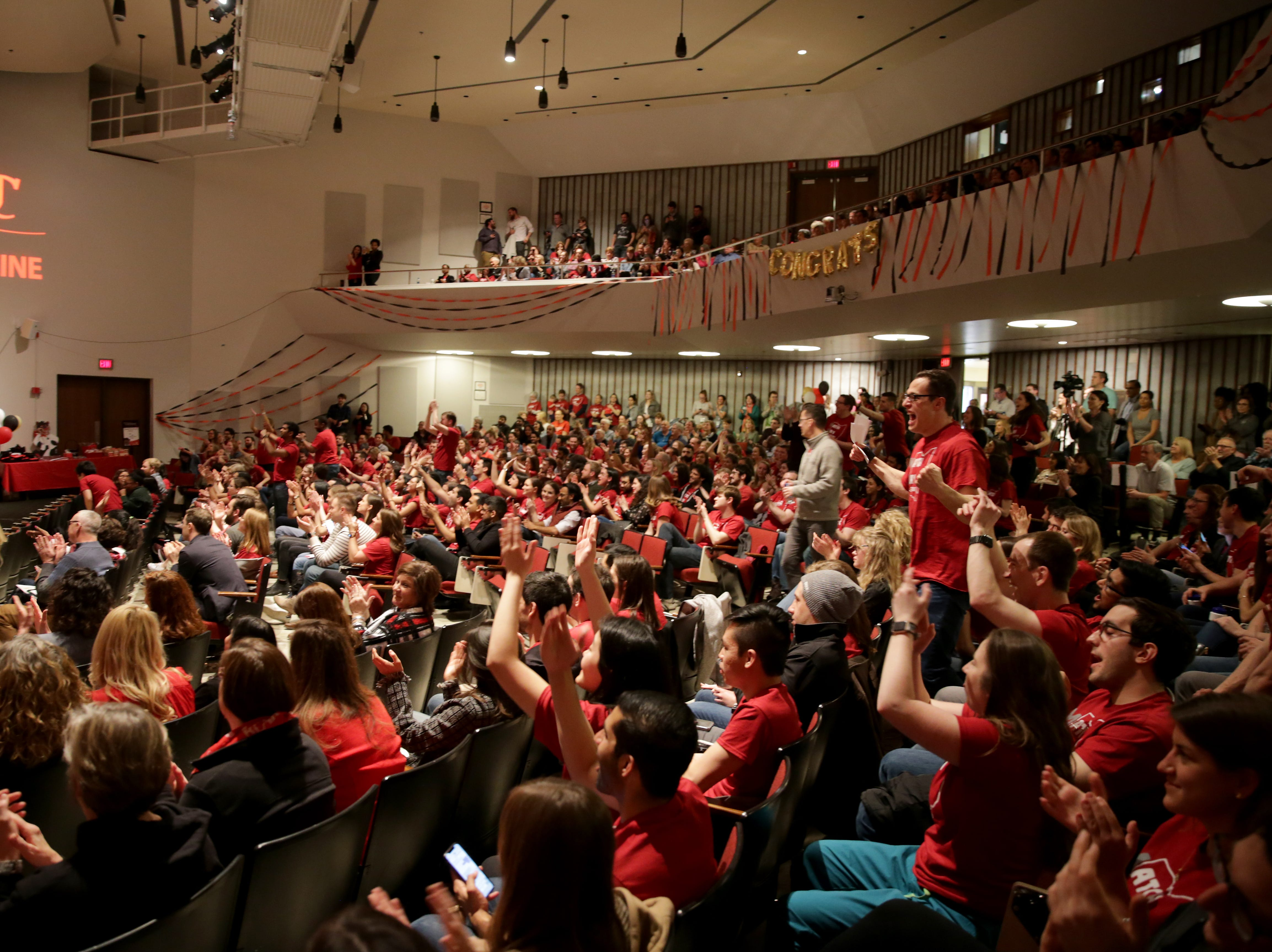 University of Cincinnati College of Medicine students cheer on their classmates as the find out where they'll be doing their residencies during Match Day at the, Friday, March 15, 2019.
