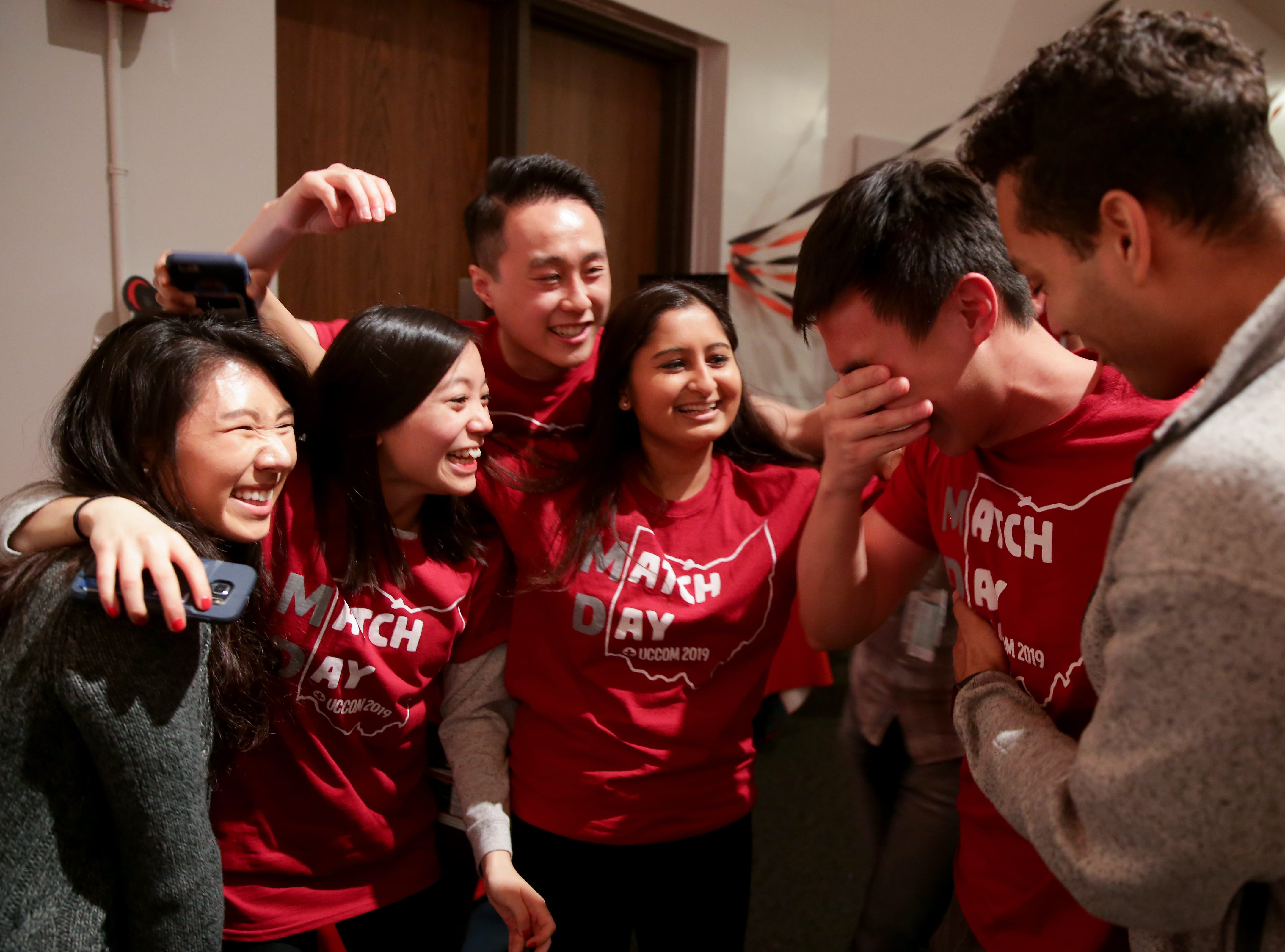 Patrick Lee, center, wipes away tears after finding out he will doing his residency in internal medicine at the University of Southern California, during Match Day, Friday, March 15, 2019, at the University of Cincinnati's College of Medicine.