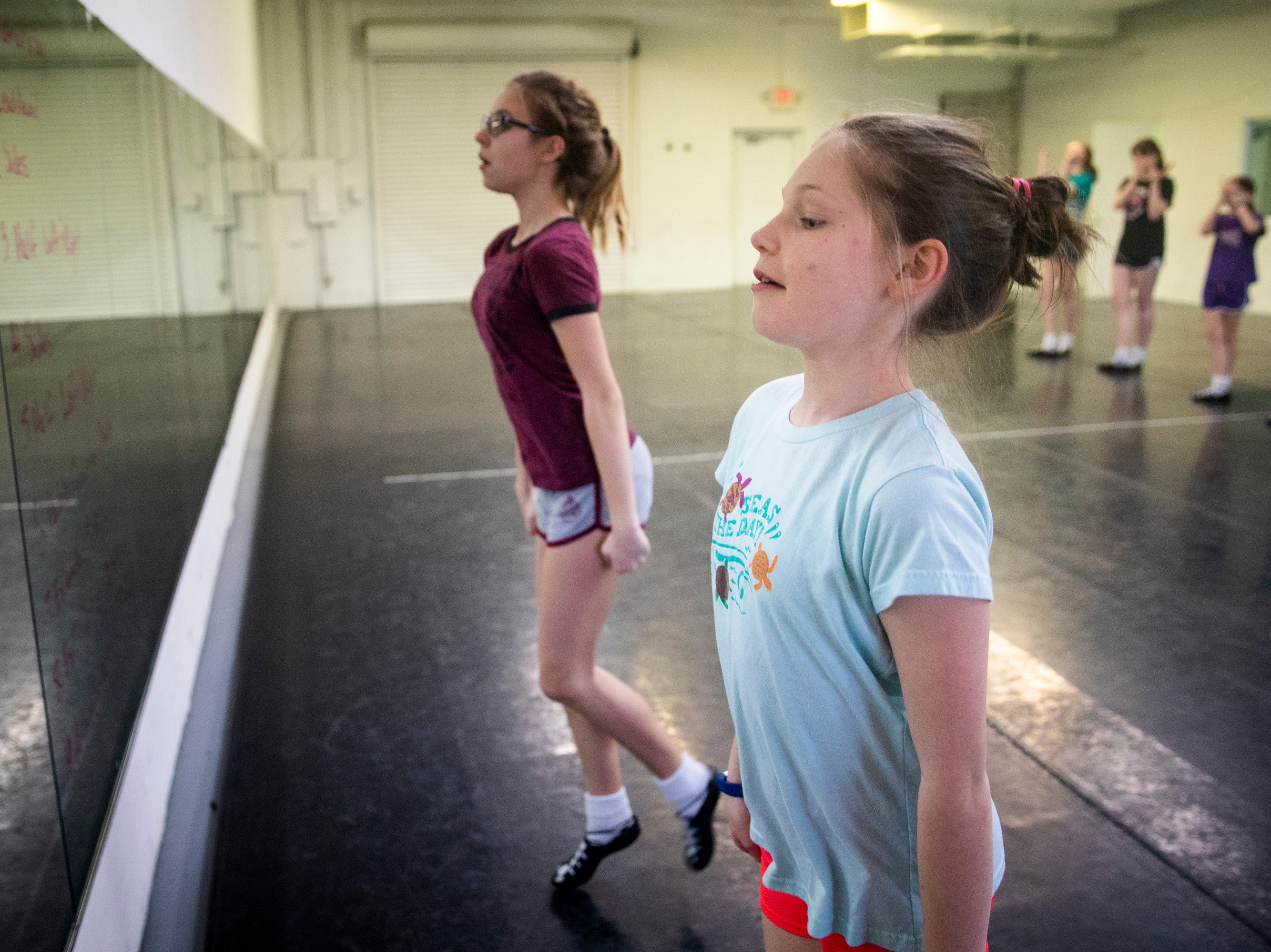 Emily Bolan, 10, and Grace Arnold, 14, practice for the 2019 Cincinnati St. Patrick's Day Parade at the Erickson Academy of Irish Dance studio in Linwood Thursday, March 14, 2019.