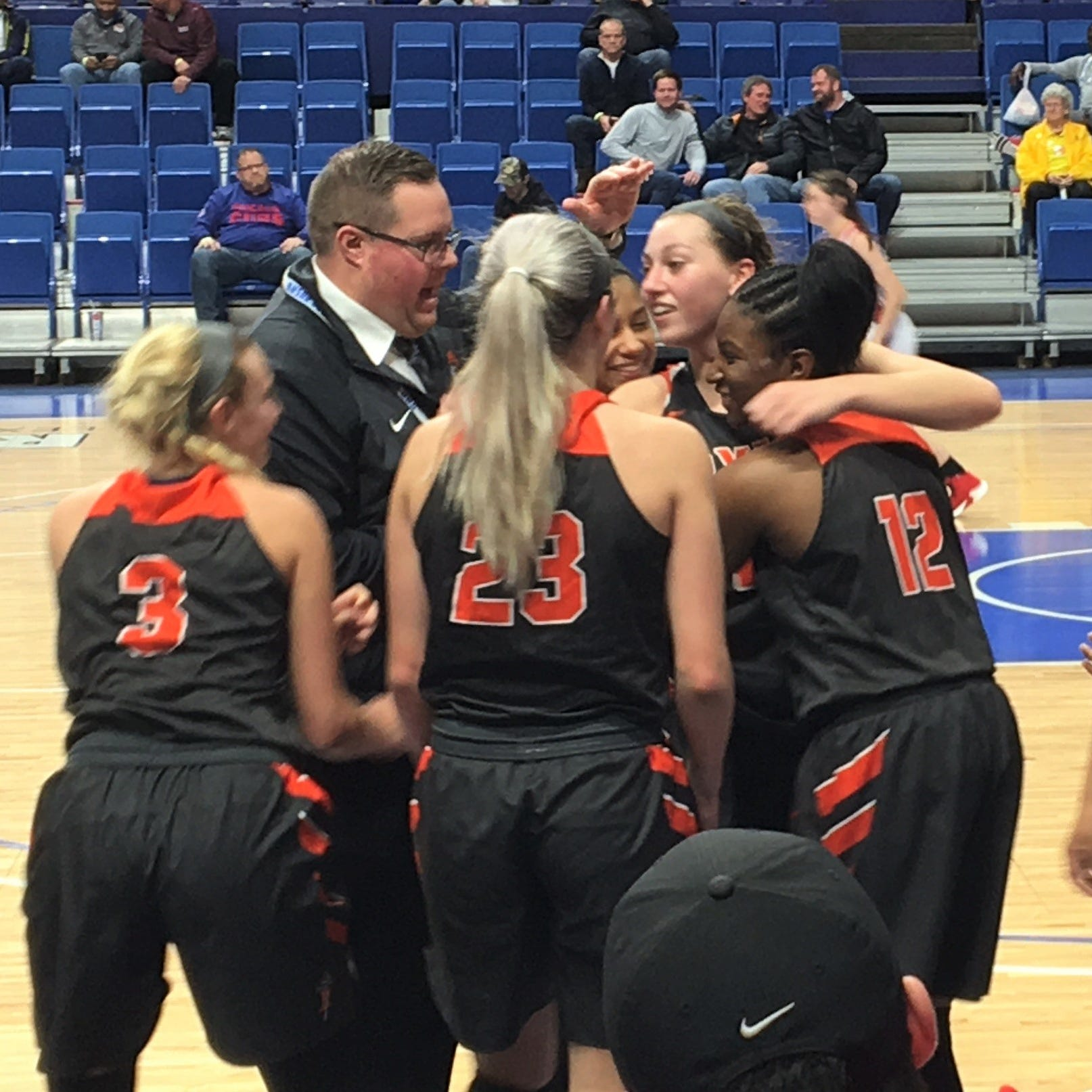 Ryle players celebrate the final seconds of their win in the state quarterfinals
