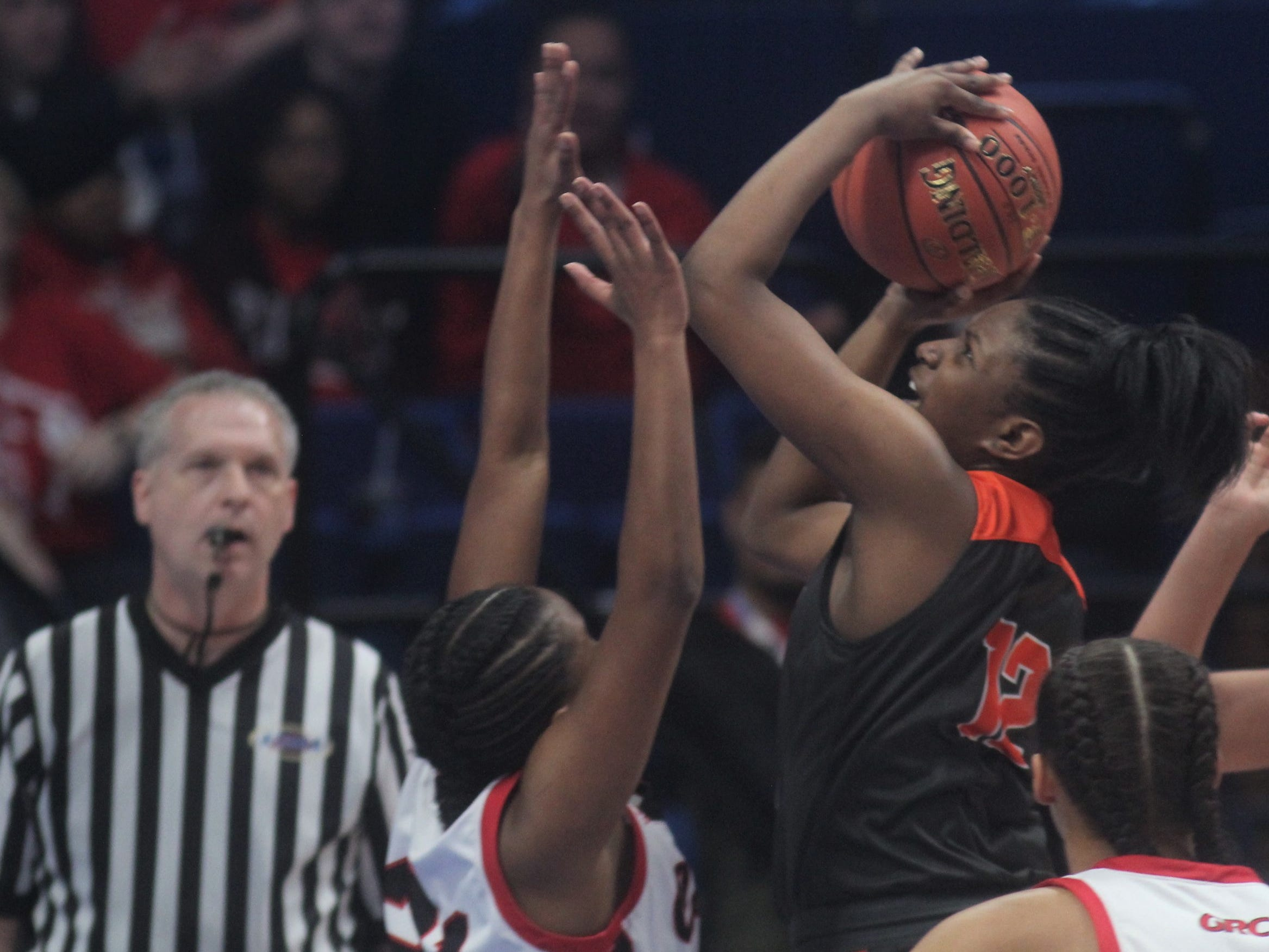 Ryle's Austin Johnson puts up a shot as Ryle defeated George Rogers Clark 64-51 in the state quarterfinals of the KHSAA Sweet 16 girls basketball tournament March 15, 2019 at Rupp Arena, Lexington KY.