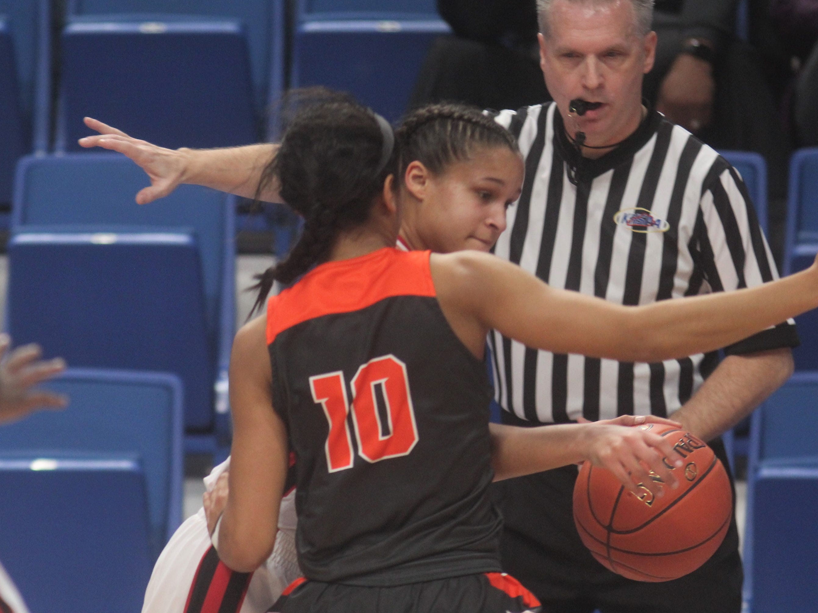 Ryle senior Juliet McGregor pressures her GRC opponent as Ryle defeated George Rogers Clark 64-51 in the state quarterfinals of the KHSAA Sweet 16 girls basketball tournament March 15, 2019 at Rupp Arena, Lexington KY.