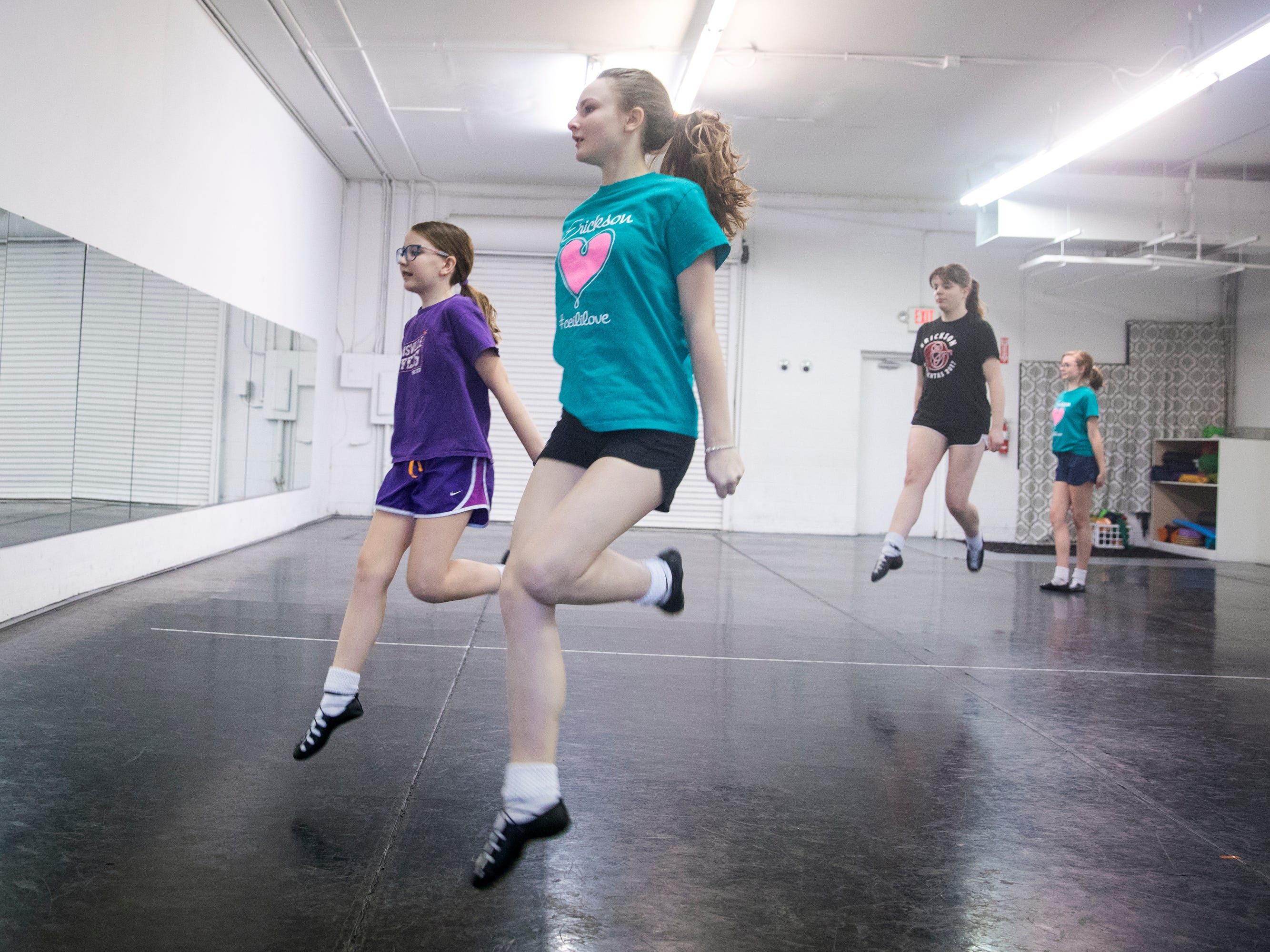 Avery Barter, 13, and Erin Stroup, 10, practice for the 2019 Cincinnati St. Patrick's Day Parade at the Erickson Academy of Irish Dance studio in Linwood Thursday, March 14, 2019.
