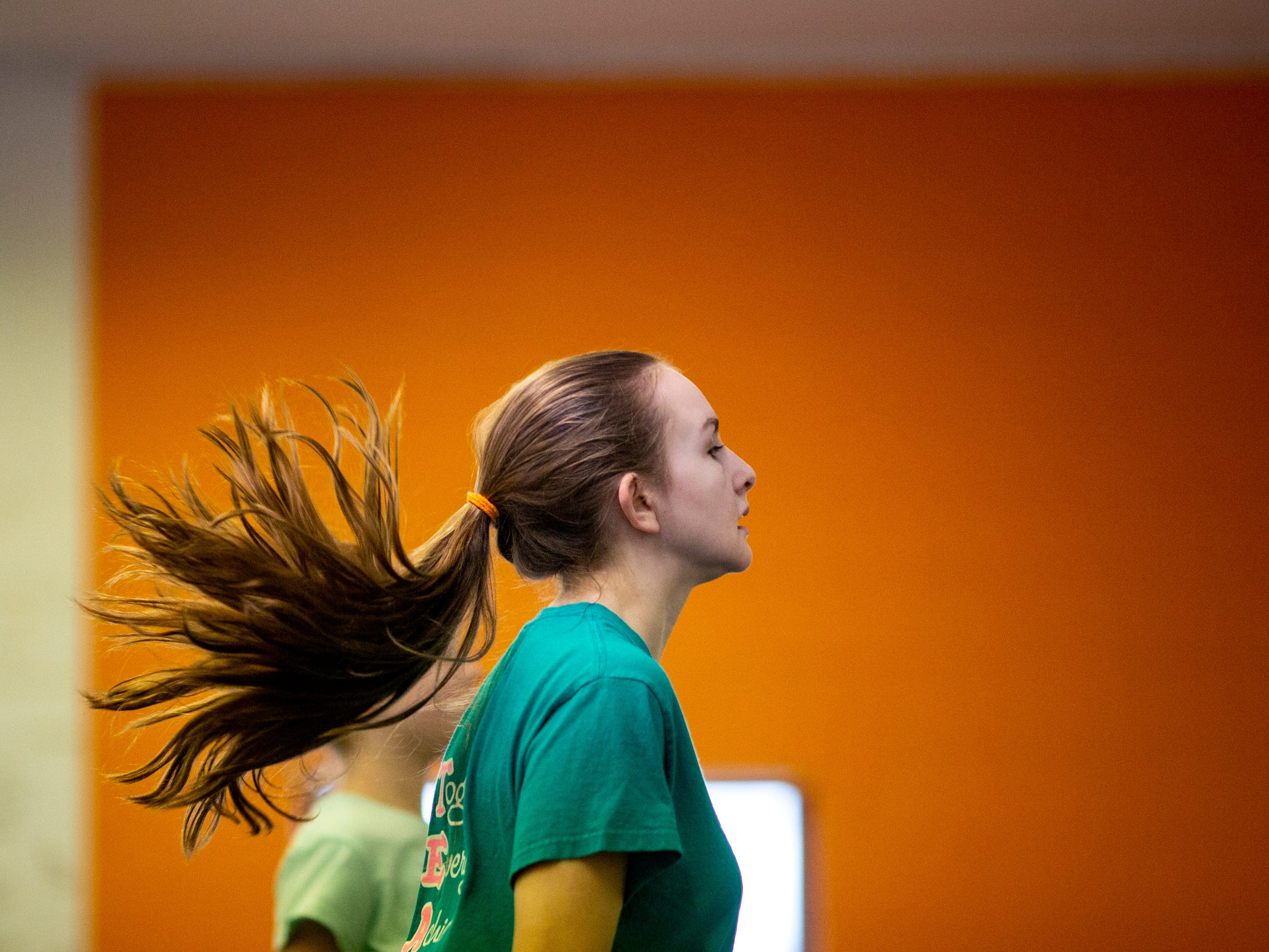 Avery Barter, 13, practices a jig at the Erickson Academy of Irish Dance studio in Linwood Thursday, March 14, 2019. The dancers will be performing at 2019 Cincinnati St. Patrick's Day Parade this weekend.