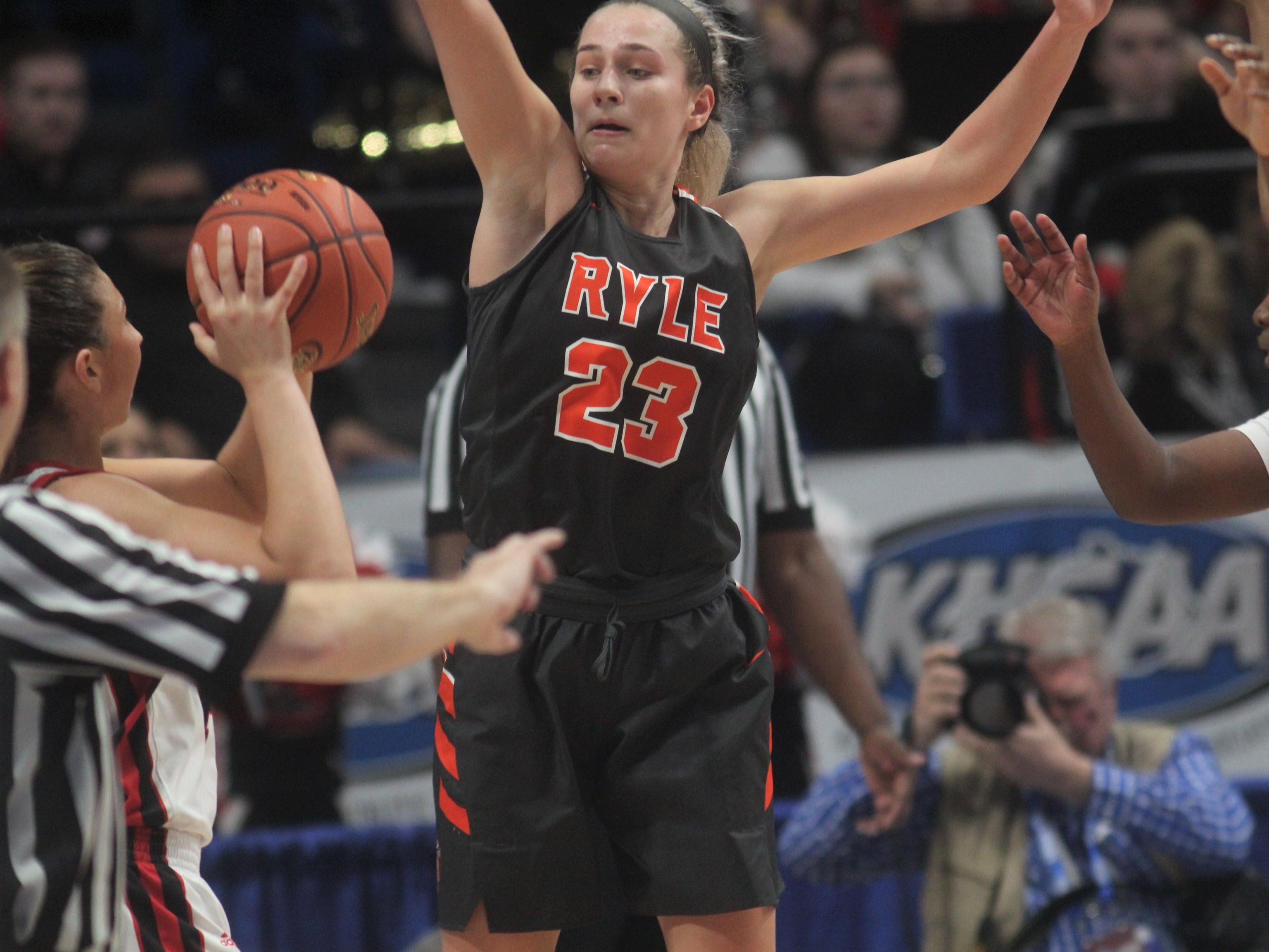 Ryle junior Maddie Scherr pressures the GRC passer as Ryle defeated George Rogers Clark 64-51 in the state quarterfinals of the KHSAA Sweet 16 girls basketball tournament March 15, 2019 at Rupp Arena, Lexington KY.