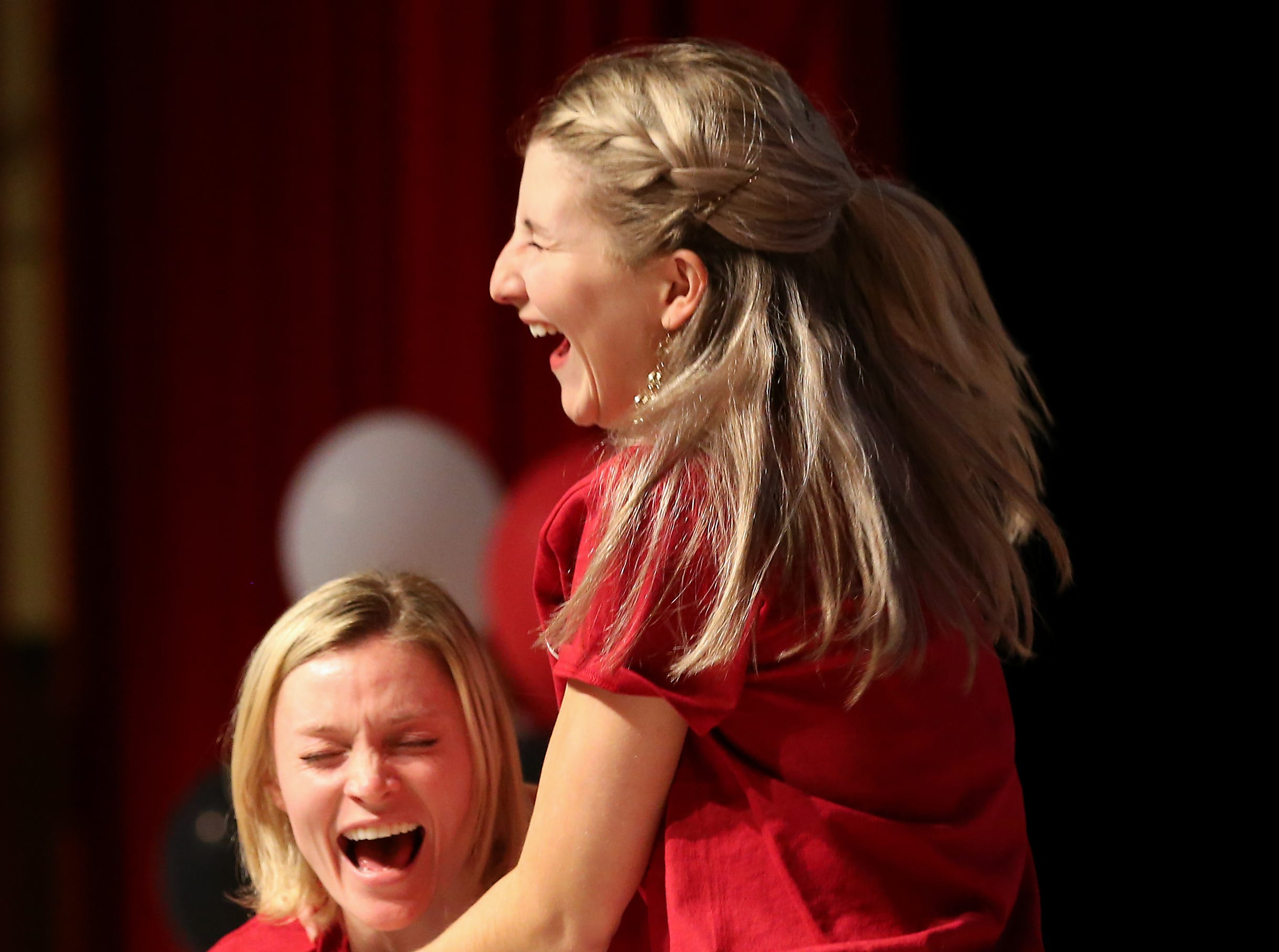 Morgan Ferros, left, reacts with her friend Helen Mulachy, right, after finding out she will doing her residency in emergency medicine at the University of Utah during Match Day, Friday, March 15, 2019, at the University of Cincinnati's College of Medicine.