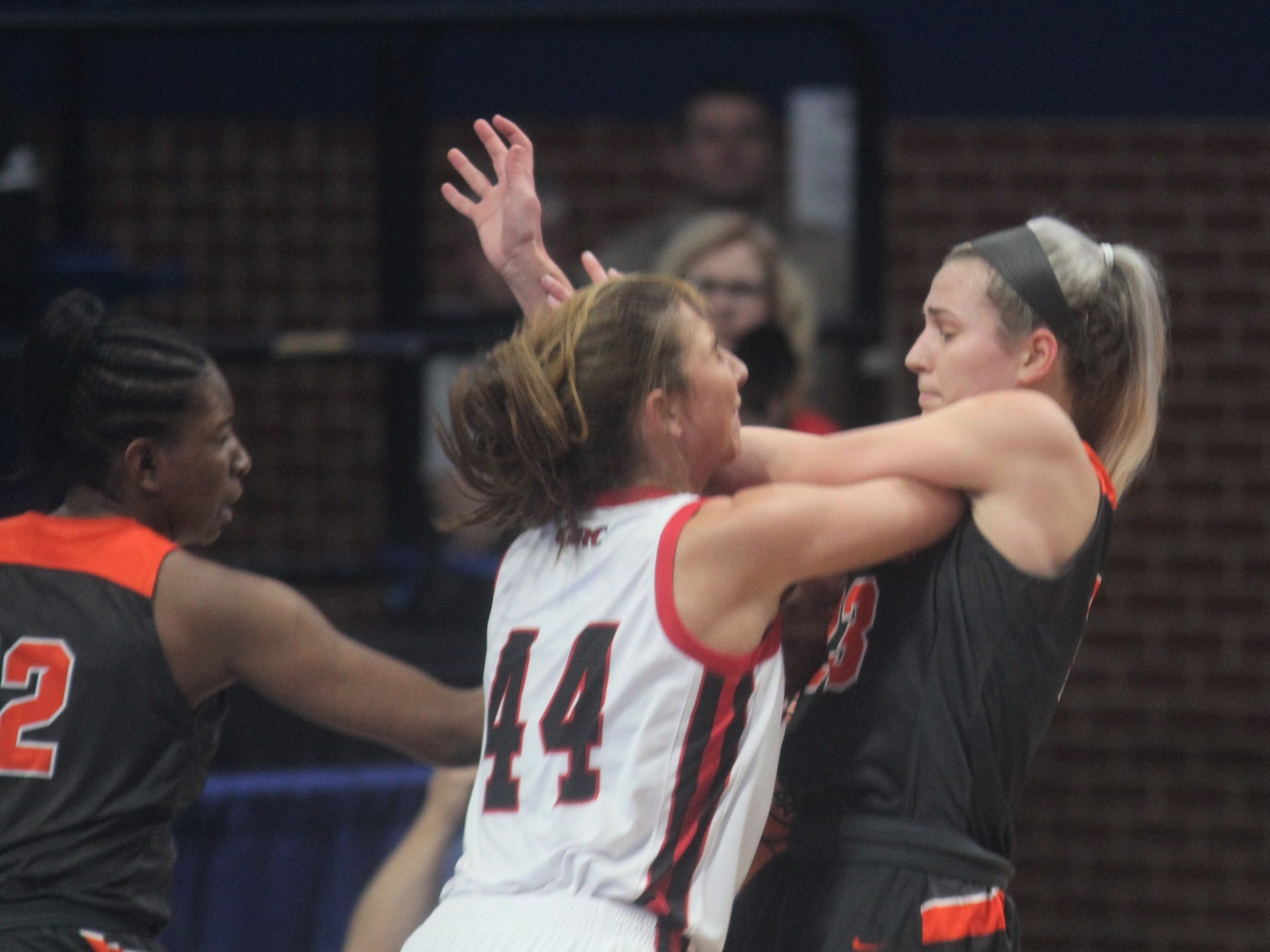Ryle junior Maddie Scherr and GRC's Hayley Harrison get tangled up as Ryle defeated George Rogers Clark 64-51 in the state quarterfinals of the KHSAA Sweet 16 girls basketball tournament March 15, 2019 at Rupp Arena, Lexington KY.
