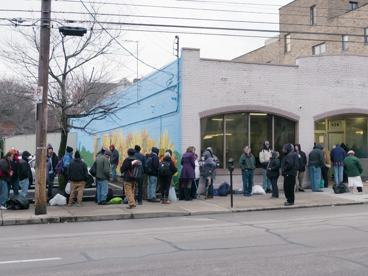 Guests line up during a cold February evening to get into the Emergency Shelter of Northern Kentucky in Covington.