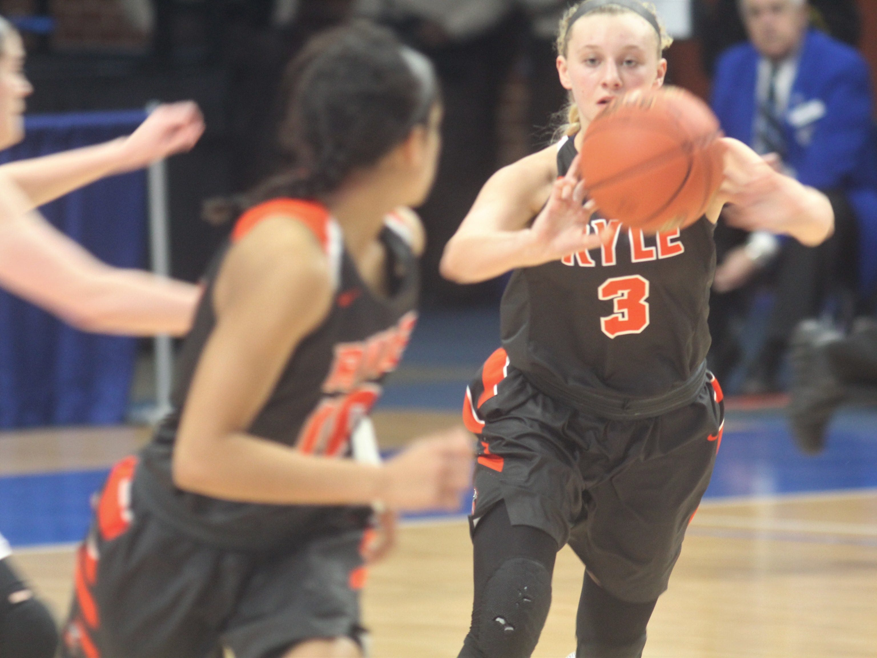 Ryle soph Brie Crittendon passes ahead in transition as Ryle defeated George Rogers Clark 64-51 in the state quarterfinals of the KHSAA Sweet 16 girls basketball tournament March 15, 2019 at Rupp Arena, Lexington KY.