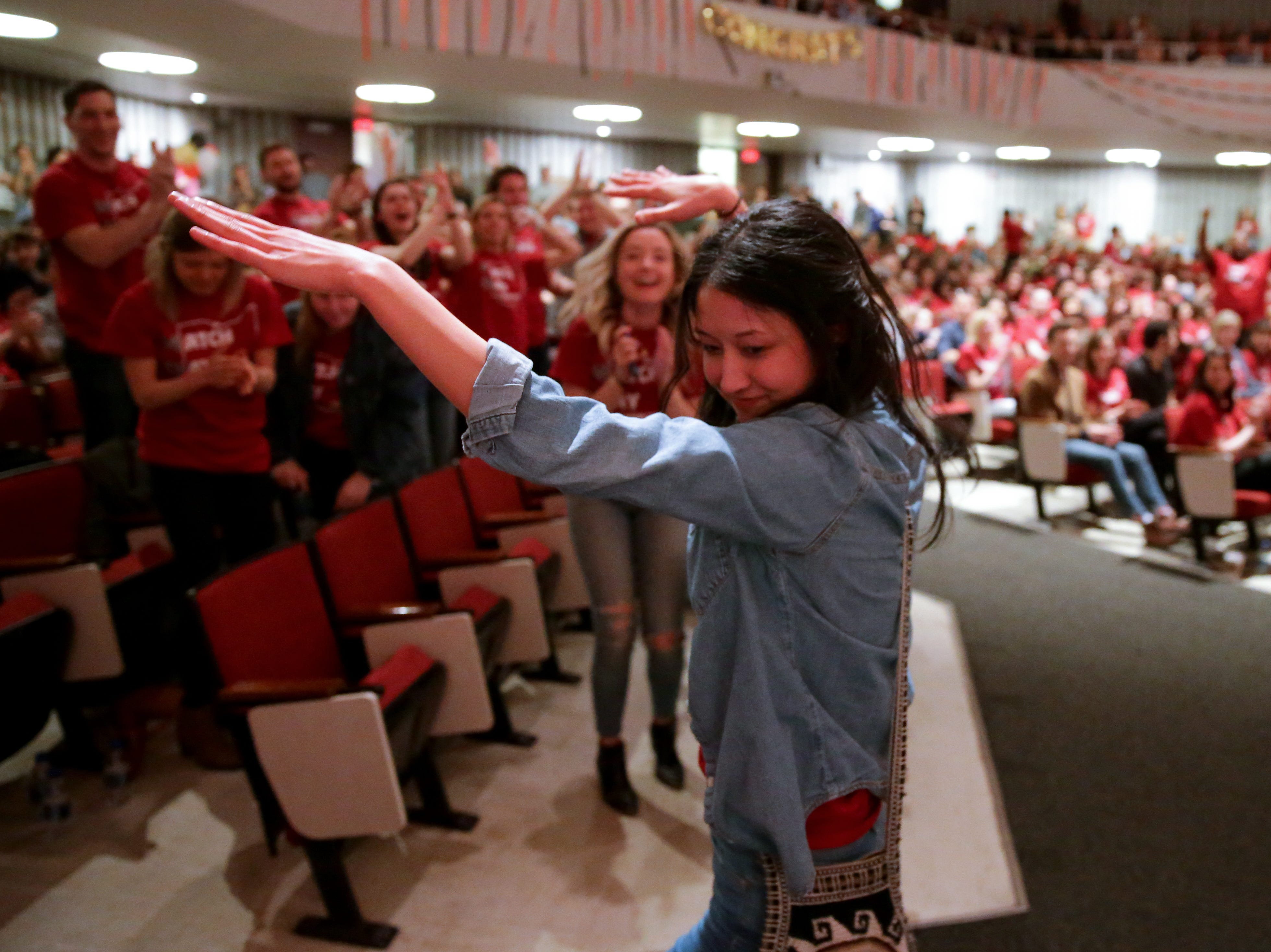 Katherine Chang makes her way to the stage to find out where she'll be doing his residency during Match Day, Friday, March 15, 2019, at the University of Cincinnati's College of Medicine.