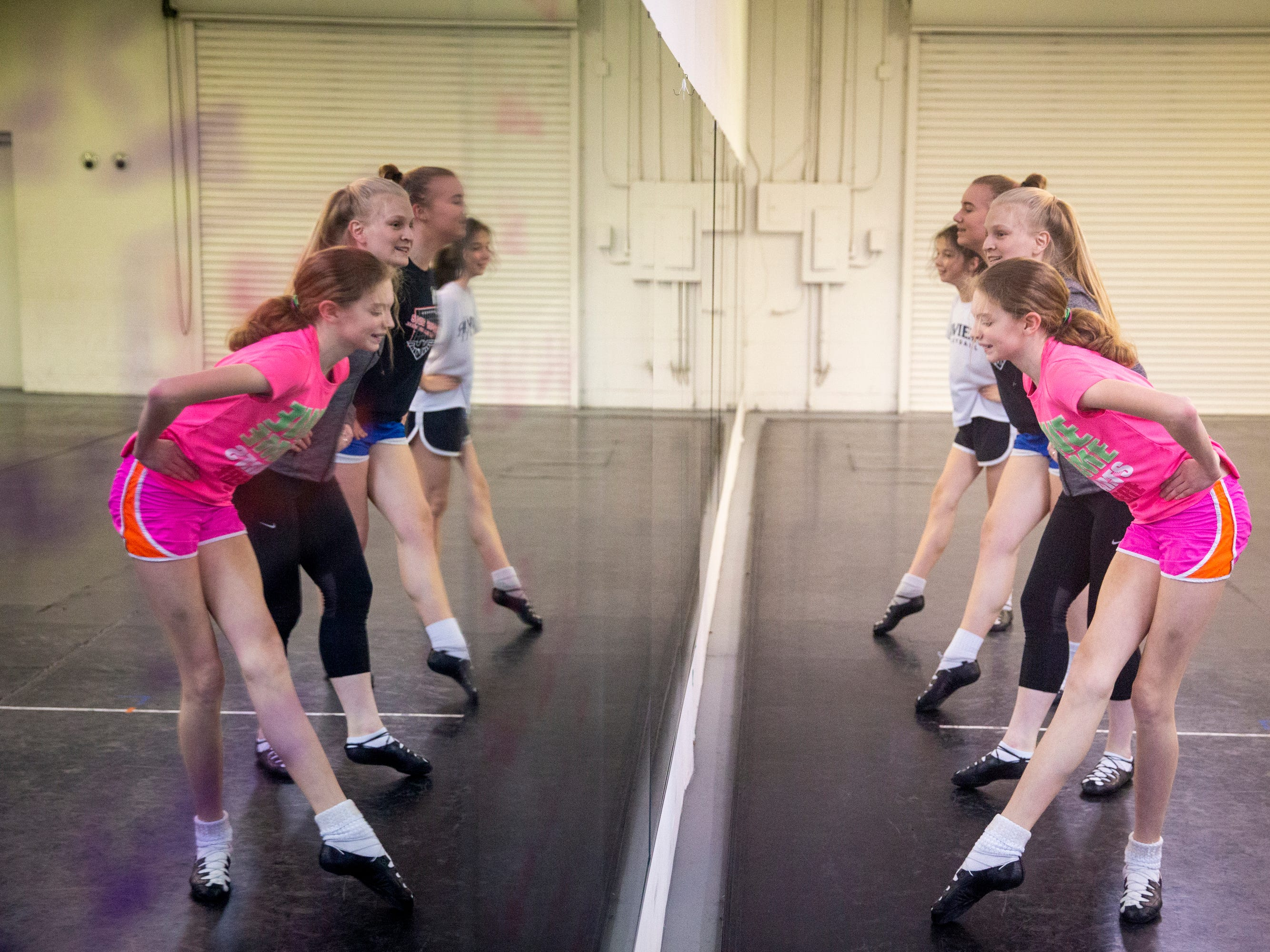 The Erickson Academy Irish dancers practice for the 2019 Cincinnati St. Patrick's Day Parade Thursday, March 14, 2019 at their studio in Linwood.